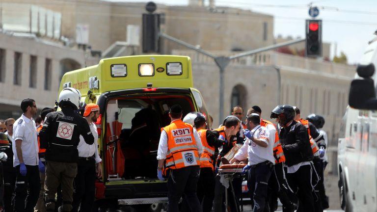 Paramedics treat an injured person following the attack