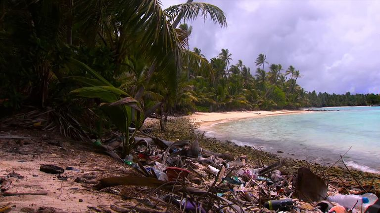 A beach in the Cocos Keeling Islands covered in litter