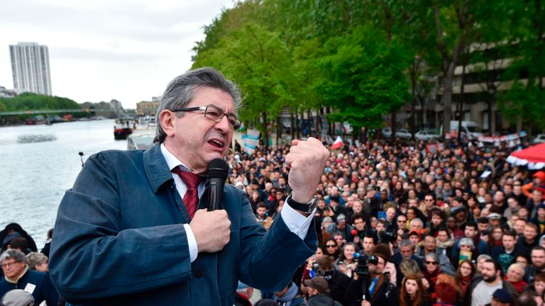 Jean-Luc Melenchon gives a speech aboard an 'unbowed' barge