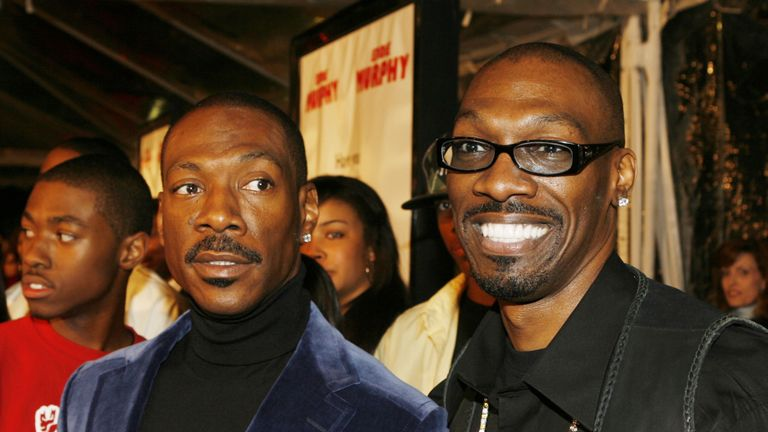 Charlie Murphy (R) co-wrote Norbit, which starred his younger brother Eddie