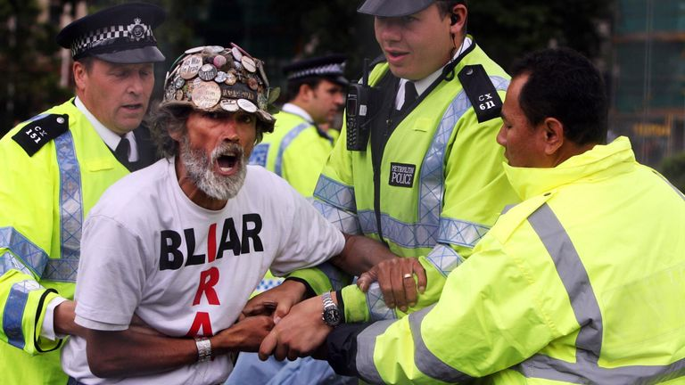 Peace campaigner Brian Haw with police after letters were issued to campers asking them to leave Parliament Square in 2007