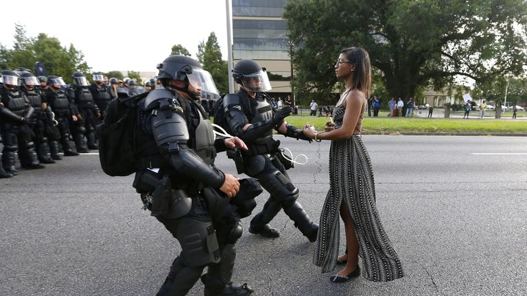 Protester Ieshia Evans is approached by law enforcement near the headquarters of the Baton Rouge Police Department in Baton Rouge, Louisiana, U.S. July 9, 2016