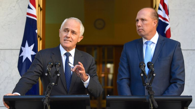 Prime Minister Malcolm Turnbull speaks alongside immigration minister Peter Dutton