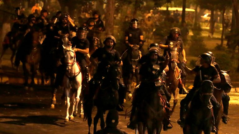 Police on horseback try to quell the unrest in the city of Asuncion