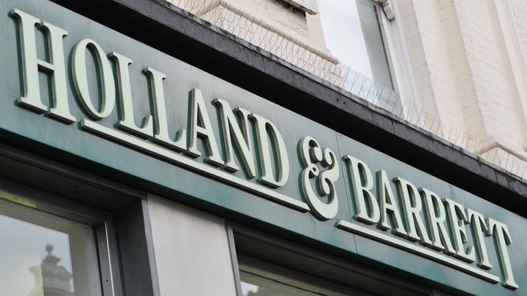 A shop sign for Holland and Barrett in central London