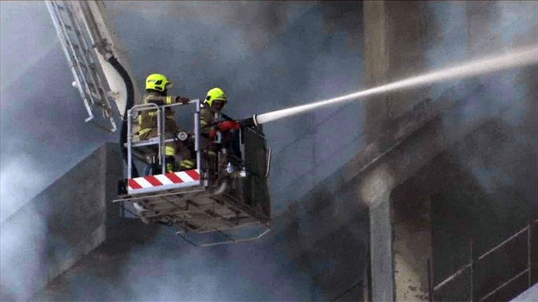 Firefighters battle the blaze at a Dubai residential complex that is under construction