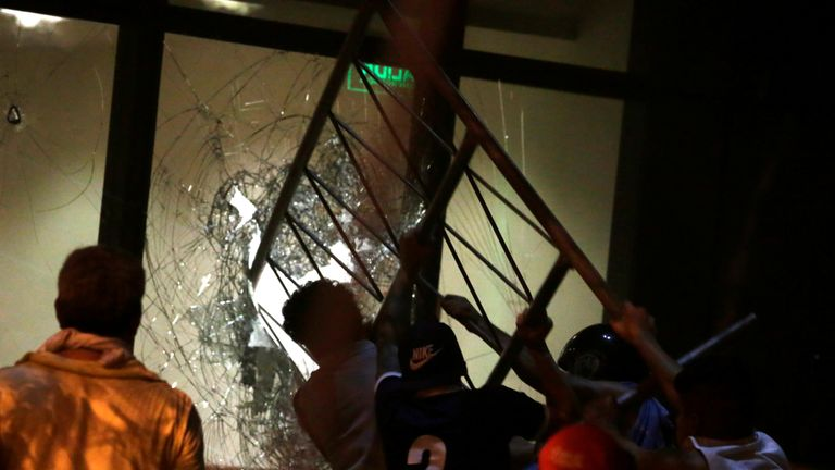 Rioters smash windows of the Congress building in anger at the secret vote