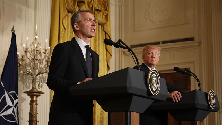 Jens Stoltenberg (L) and Donald Trump