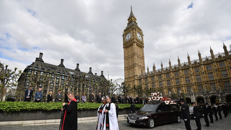 The hearse carrying the coffin of PC Keith Palmer leaves the Palace of Westminster