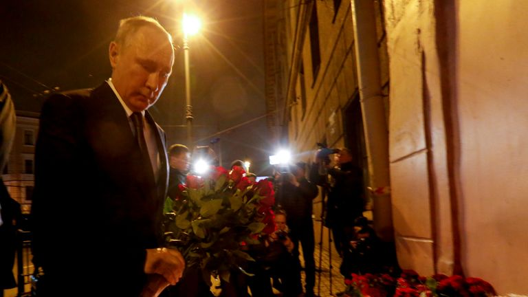 Vladimir Putin lays flowers outside Technology Institute station