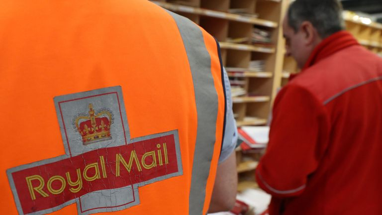 File photo dated 15/12/16 of a Royal Mail worker at a sorting office.