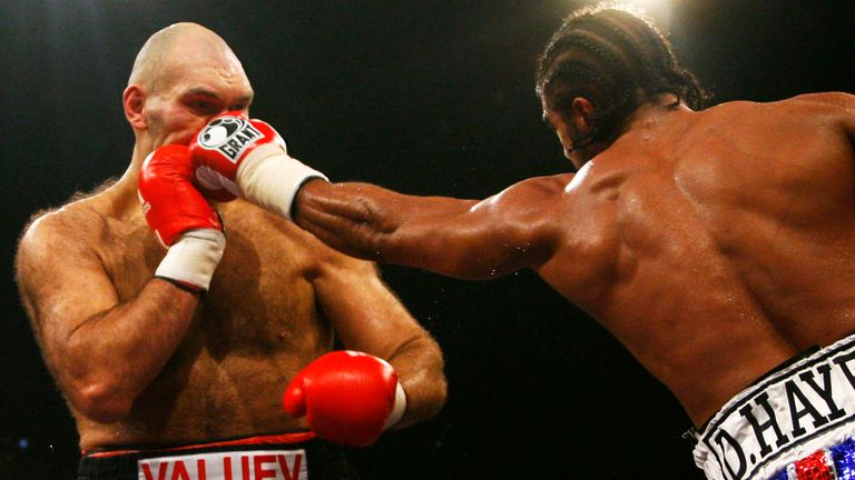 Russian WBA heavyweight champion Nikolai Valuev (L) vies with British challenger David Haye