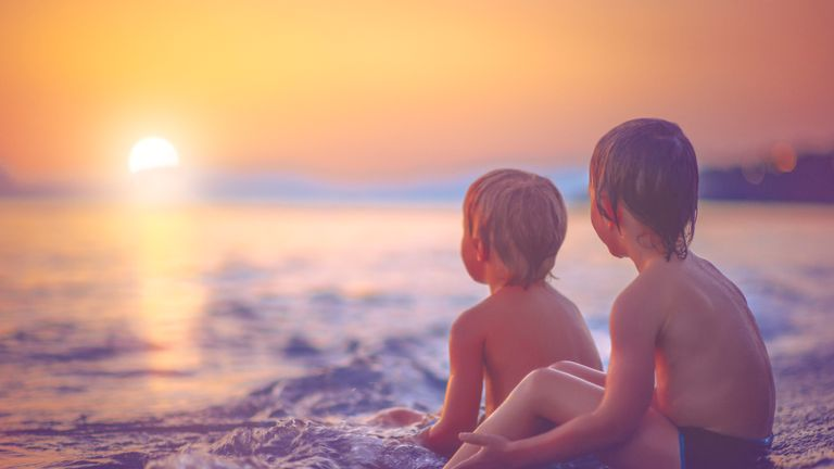 Children enjoying a sunset on holiday