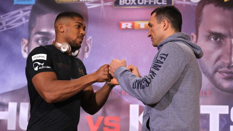 Anthony Joshua and Wladimir Klitschko face-to-face at a news conference before the big fight