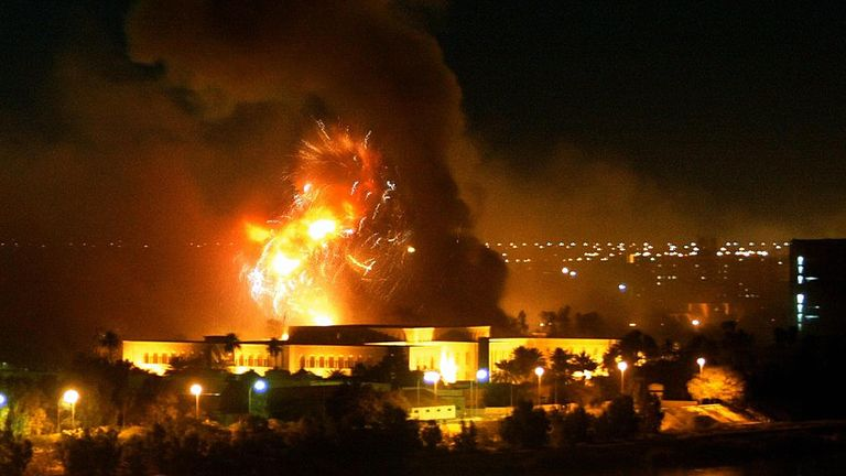 Smoke covers the presidential palace compound during a massive US-led air raid in Baghdad 21 March 2003