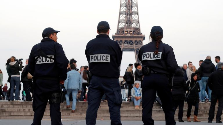 Police patrol at the Trocadero near the Eiffel Tower