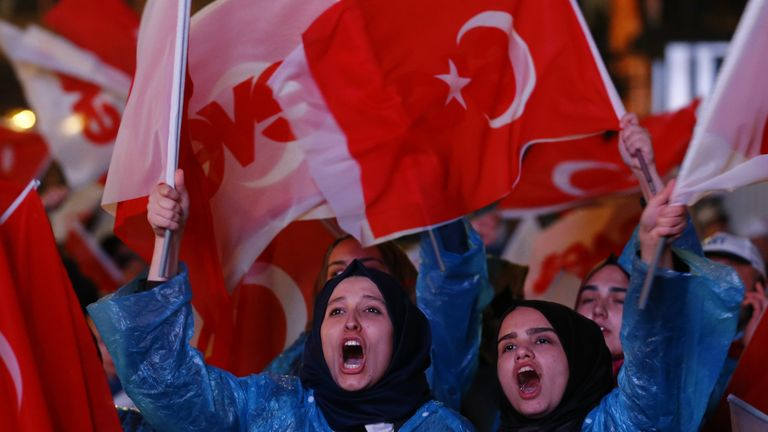 AK party supporters react as polling numbers are revealed at the party headquarters in Ankara