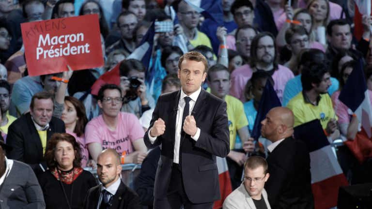 Emmanuel Macron delivers a speech during a campaign rally