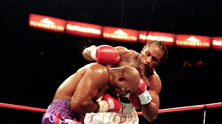 Lennox Lewis lands a right hook to the head of Evander Holyfield