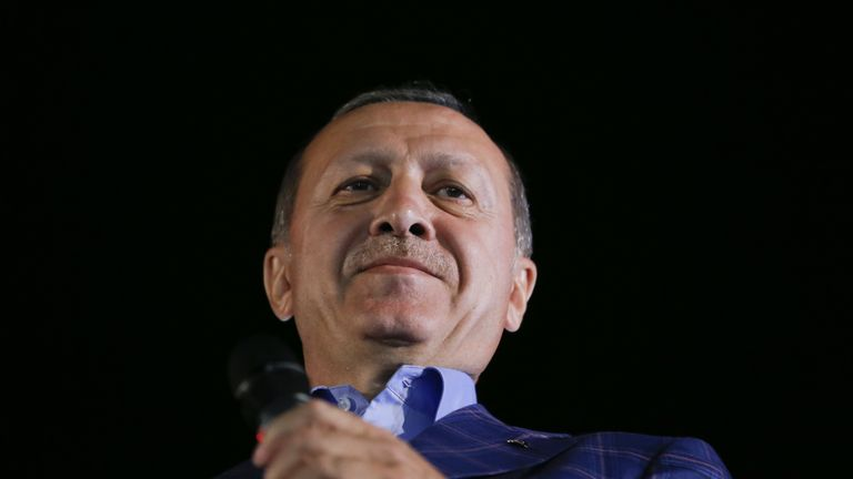 Turkish President Recep Tayyip Erdogan greets his supporters in Istanbul