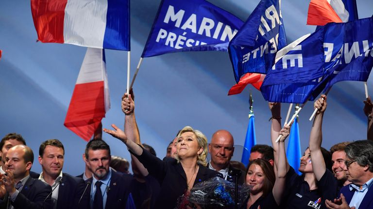 Supporters gather around Ms Le Pen at her rally in Marseille