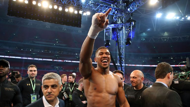 Anthony Joshua celebrates victory over Wladimir Klitschko following the IBF, WBA and IBO Heavyweight World Title bout with Mayor of London Sadiq Khan