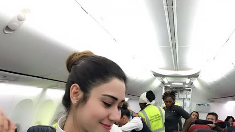 A flight attendant holds the newborn baby. Pic: Turkish Airlines