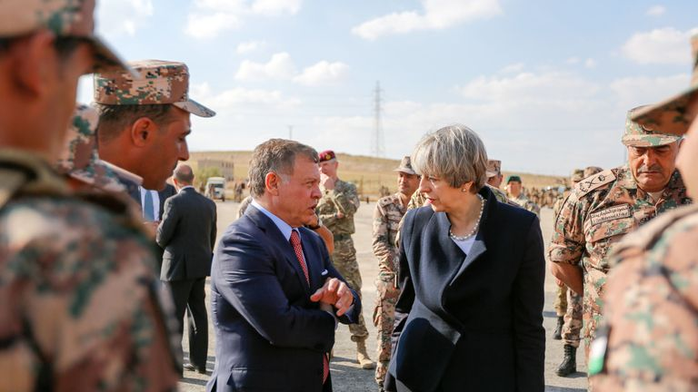 In this handout photo supplied by the Jordanian Royal Palace, King Abdullah II of Jordan talking to British Prime Minster Theresa May during their visit at a military base on April 3, 2017 in near Amman, Jordan