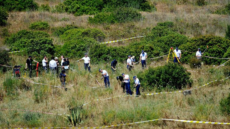 British police and their Portuguese counterpartsl during a search of a patch of scrubland just outside of the small coastal town as the search for clues enters a second week