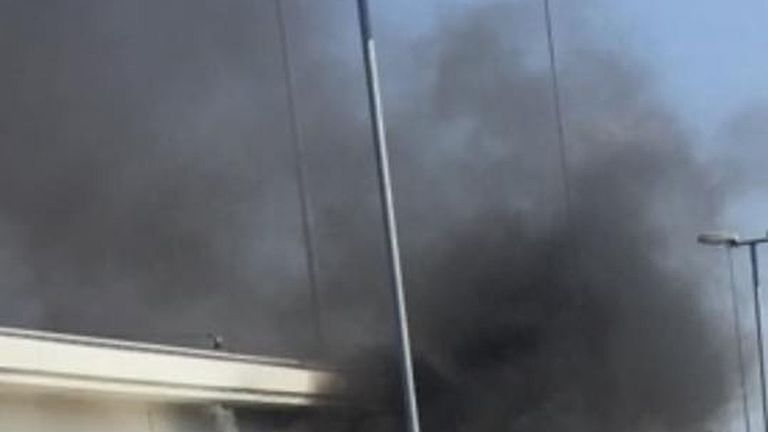 The car was reportedly already on fire when it rolled up to the window