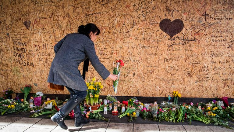Messages of condolence have been written on plywood surrounding the crash site