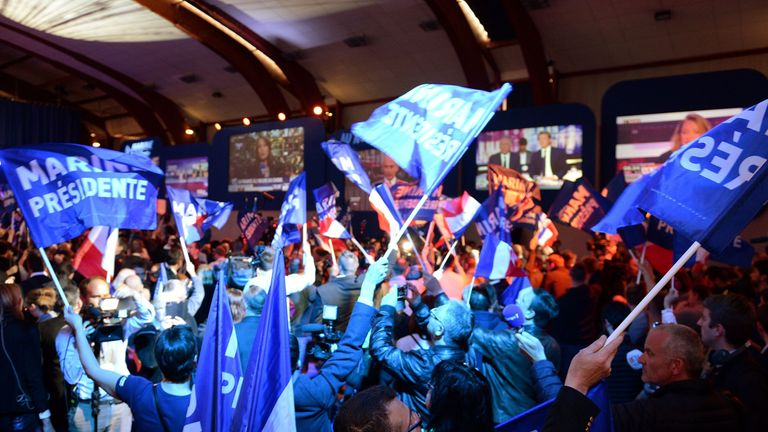 Supporters of French presidential election candidate for the far-right Front National party react after the announcement of the results of the first round of the presidential election on April 23, 2017 in Henin-Beaumont, north-western France