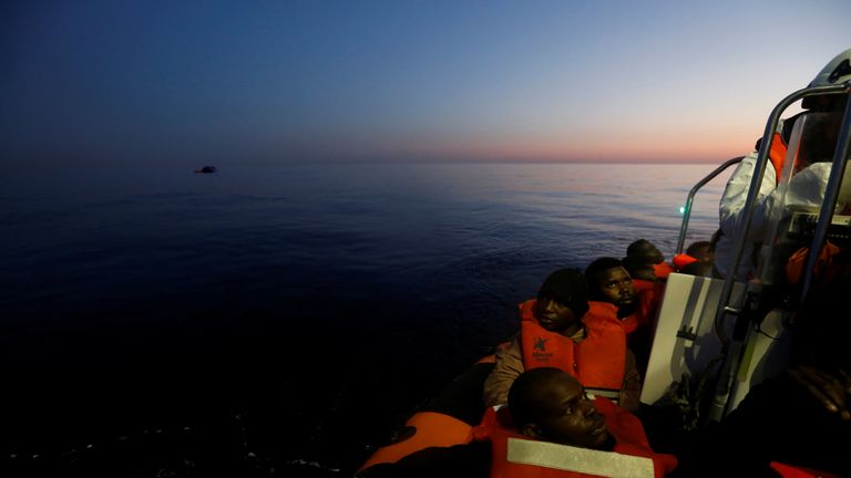 Migrants rescued from a rubber dinghy off Libya