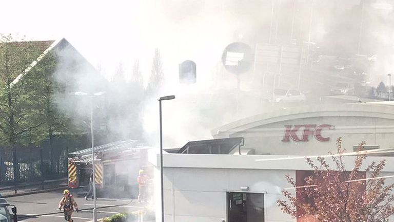 Firefighters tackle the blaze at the KFC