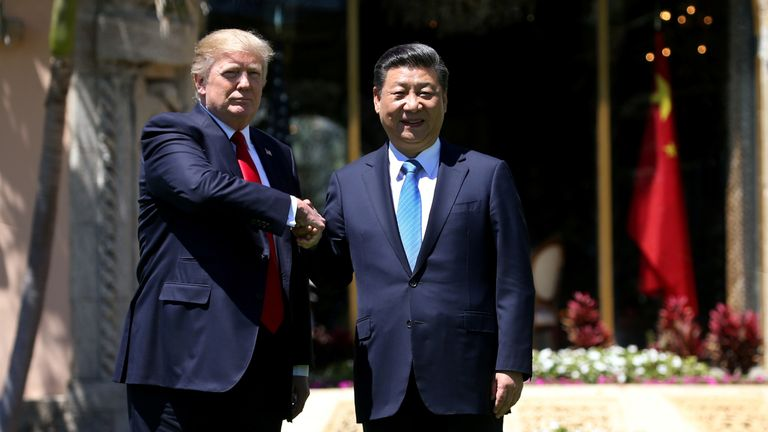 President Donald Trump (L) and China's President Xi Jinping