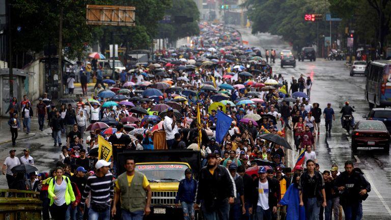 Demonstrators rally against Venezuela's President Nicolas Maduro in Caracas, Venezuela