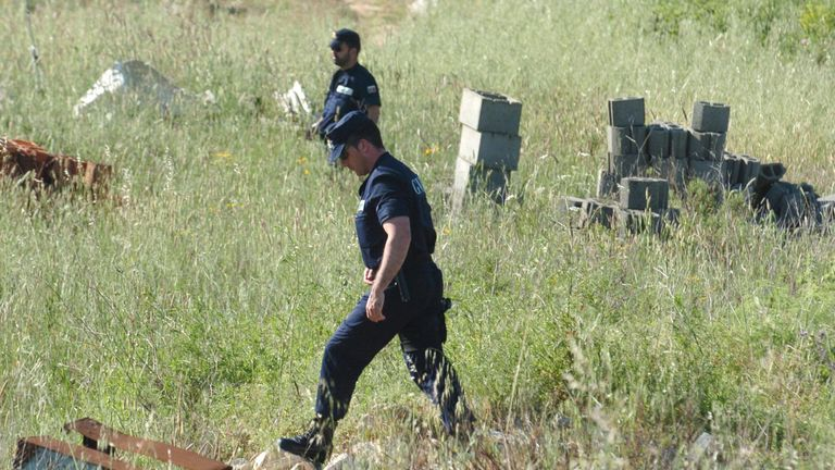 2007: Police looking for Madeleine McCann search the field near Luzt Portugal