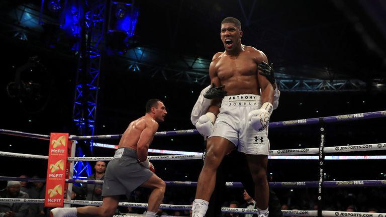 LONDON, ENGLAND - APRIL 29:  Anthony Joshua (White Shorts) puts Wladimir Klitschko (Gray Shorts) down in the 5th round during the IBF, WBA and IBO Heavywei