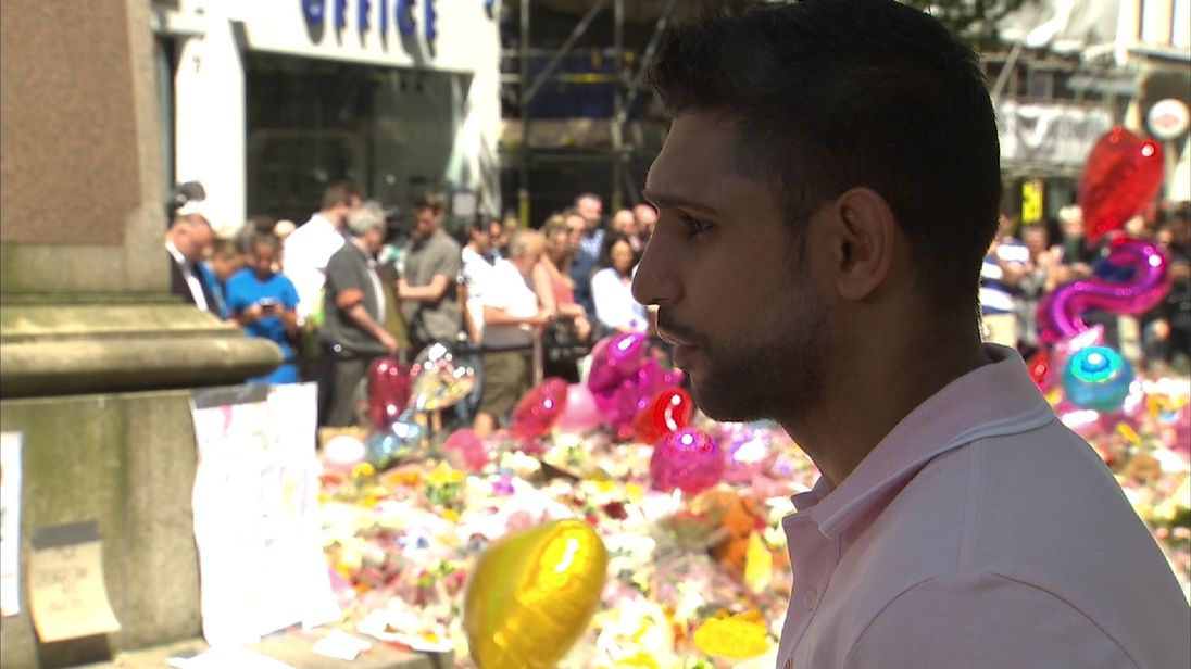 Boxer Amir Khan paid his respects to the people killed in the Manchester attack