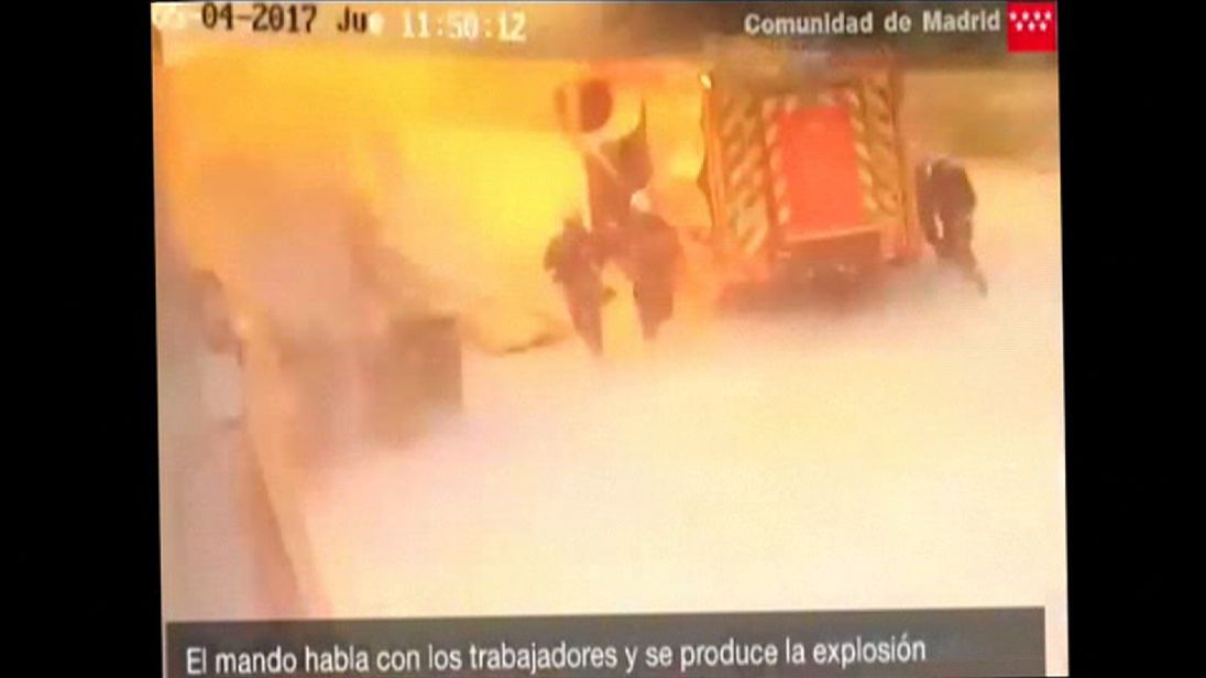 Firefighters are engulfed in an explosion at a Madrid waste plant