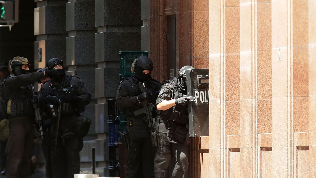 Armed policeman are seen outside Lindt Cafe on Philip St, Martin Place on December 15, 2014 in Sydney, Australia