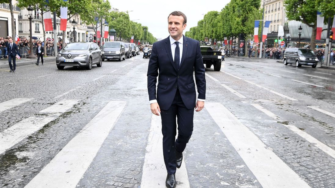 French President Emmanuel Macron walks to the Arc du Triomphe monument
