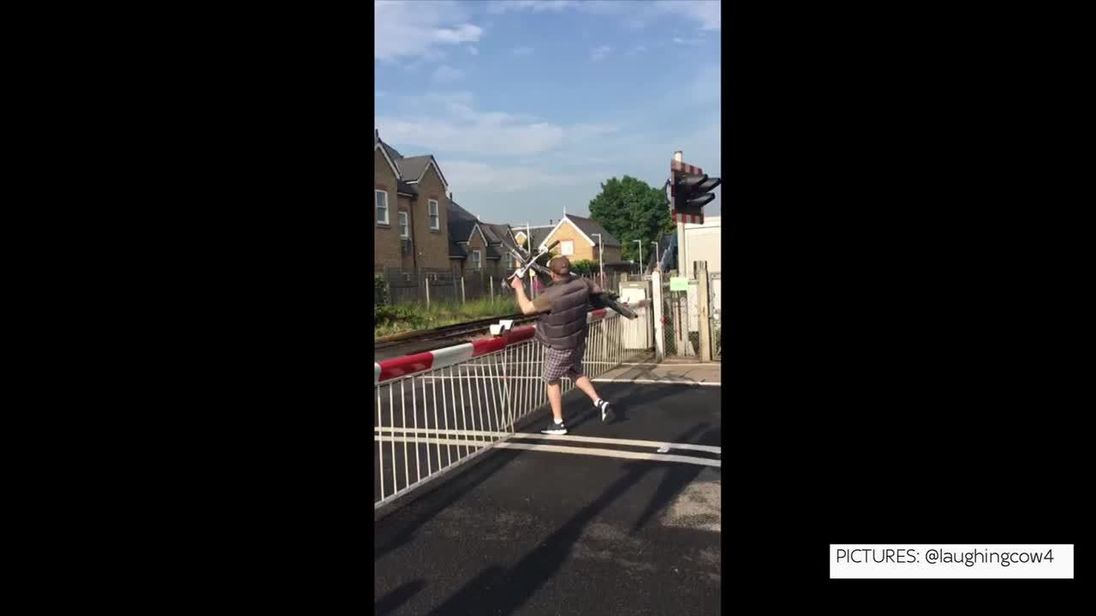 Cyclist narrowly misses train after ignoring barrier at level crossing