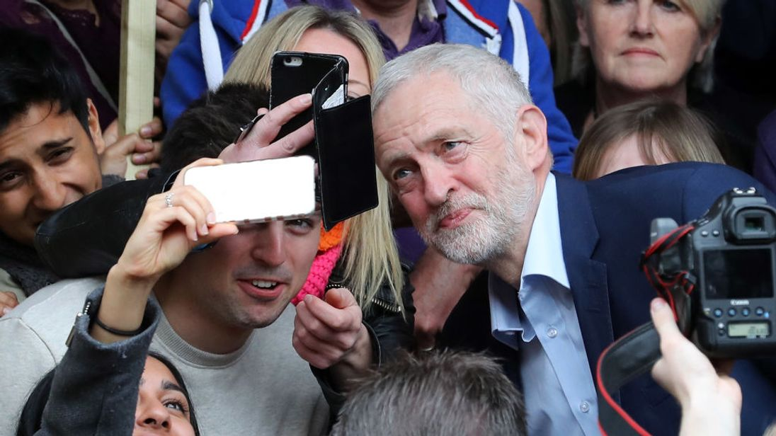Jeremy Corbyn poses for a selfie outside Leamington Spa Town Hall