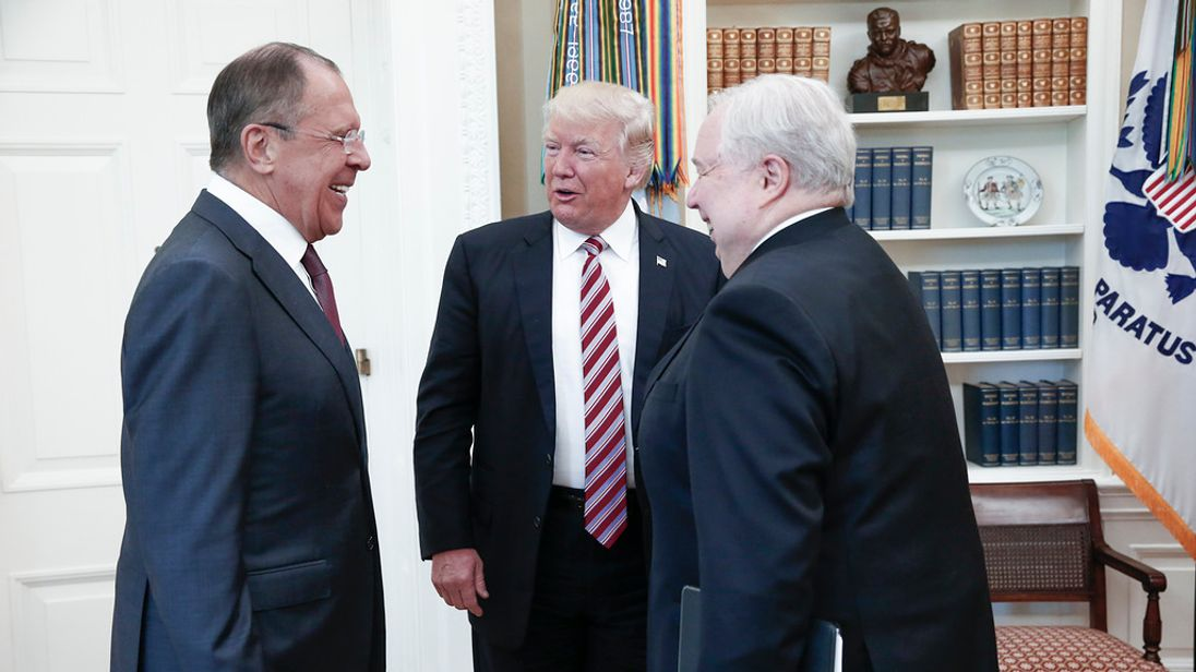 During a break Mr Trump jokes with Mr Lavrov (left) and Ambassador Sergei Kislyak (right). MFA Russia