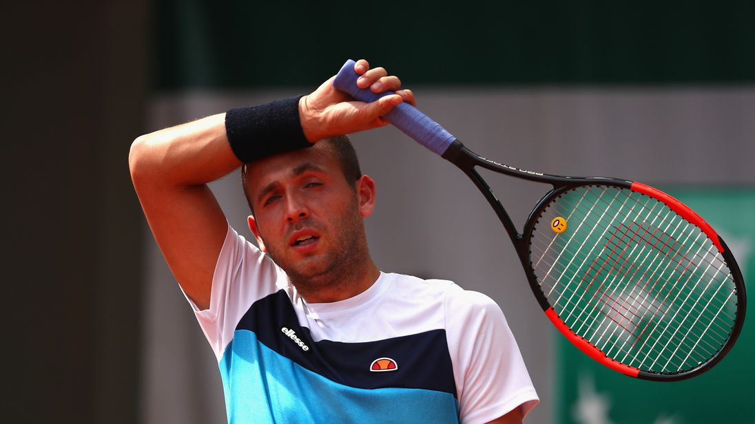 Dan Evans of Great Britain reacts during the mens singles first round match against Tommy Robredo of Spain