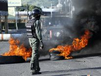 Riot security forces clash with demonstrators during a protest against Venezuela's President Nicolas Maduro's government in Tariba