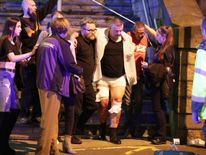 An injured man is helped away from the arena Pic: Joel Goodman/LNP