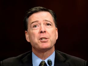 FBI Director James Comey said he felt nauseous over claims his actions influenced the presidential election