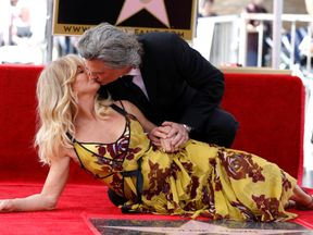 Actors Kurt Russell and Goldie Hawn kiss after unveiling their stars on the Hollywood Walk of Fame